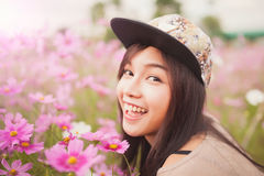 Beautiful asian women smiling in pink cosmos flower field Royalty Free Stock Image
