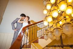 Beautiful asian young bride and groom kissing Royalty Free Stock Photos