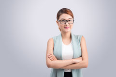 Beautiful asian young business woman on grey background. Stock Images