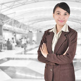 Beautiful Asian young businesswoman. Standing with hands folded Stock Photos