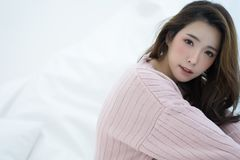 Beautiful Asian young smiling woman warm sweater pink cold and r stock photo