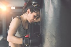 Asian young woman doing exercise with Thai boxing Muay Thai eq. Beautiful asian young woman doing exercise with Thai boxing Muay Thai equipment in gym. Health Stock Photography