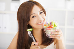 Beautiful asian young woman eating healthy food. Healthy life concept Royalty Free Stock Photos