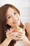 Beautiful asian young woman eating salad Stock Photo