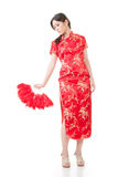 Beautiful asian young woman with fan in cheongsam Stock Images