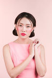 Beautiful asian young woman with fashion makeup isolated on pink Royalty Free Stock Image