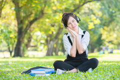 Beautiful Asian Young Woman with Headphones Outdoors. Enjoying M Royalty Free Stock Images