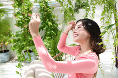 Beautiful asian young woman relaxing and taking photo selfie on bancony at home Stock Photo