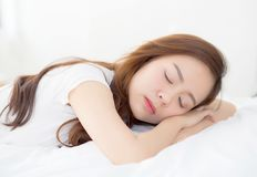 Beautiful asian young woman sleeping lying in bed with head on pillow comfortable and happy. Girl with relax for health concept Royalty Free Stock Photography