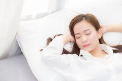 Beautiful asian young woman sleeping lying in bed with head on pillow comfortable and happy. Girl with relax for health concept stock photos