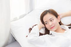 Beautiful asian young woman sleeping lying in bed with head on pillow comfortable and happy. Girl with relax for health concept Royalty Free Stock Images
