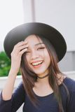 Beautiful asian young woman smiling on the city Stock Photo