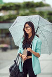 Beautiful asian young woman with tablet in city street Stock Photo