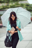 Beautiful asian young woman with tablet in city street Royalty Free Stock Photo