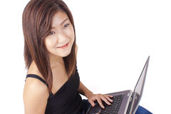 Beautiful Asian young woman typing on laptop Stock Photos