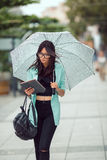 Beautiful asian young woman using tablet in the city Royalty Free Stock Images