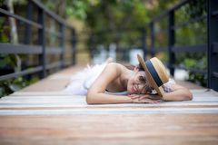 Beautiful asian younger woman lying on wood path with happiness smiling face. Beautiful asian younger  woman lying on wood path with happiness smiling face stock photography