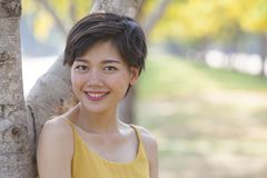 Beautiful asian younger woman toothy smiling face happiness emot. Ion Stock Images