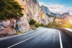 Beautiful asphalt mountain road in autumn. Colorful landscape. Beautiful asphalt road in autumn. Colorful landscape with high rocks, mountain road with a perfect royalty free stock photography