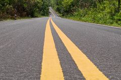 Beautiful asphalt road with vanishing point and double yellow line. With no car and nobody Stock Photo