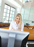 A beautiful assistant in front of a computer. A beautiful assistant on computer Stock Image