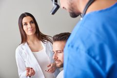 An assistant and a doctor consulting royalty free stock image