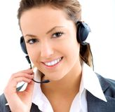 Beautiful assistant with headset. Beautiful blond assistant smiling with a headset Stock Image