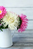 Beautiful asters in a jug on the boards Royalty Free Stock Photos