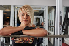 Beautiful athlete blonde woman posing in power rack Royalty Free Stock Image