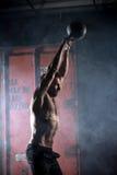 Beautiful athlete doing kettlebell swings. Profile Royalty Free Stock Photo