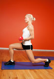 Beautiful athlete with dumbbells Stock Photography