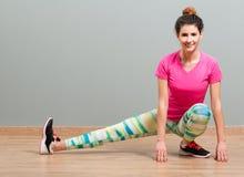 Beautiful athlete female doing fitness exercise Royalty Free Stock Images