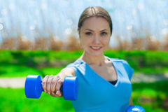 Beautiful, athlete involved in sports on the street, conducts training Royalty Free Stock Photos
