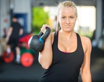 Beautiful Athlete Lifting Kettlebell Stock Photos