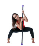 Beautiful athlete posing with fitbar in studio Royalty Free Stock Photo