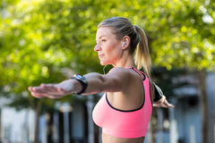 A beautiful athlete stretching her arms Royalty Free Stock Image