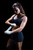 Beautiful athlete tying bandage on hand Royalty Free Stock Photos