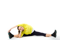 Beautiful athlete woman doing splits. Stock Photo