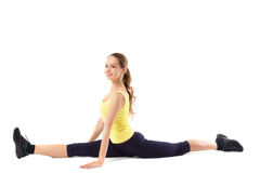 Beautiful athlete woman doing splits. Royalty Free Stock Image