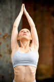 Beautiful athletic blond stretching Royalty Free Stock Photography