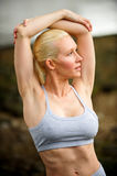 Beautiful athletic blond stretching Stock Image