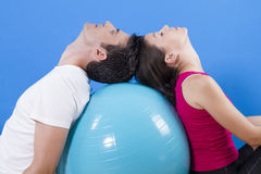 Beautiful athletic couple with fitness ball. Stock Images