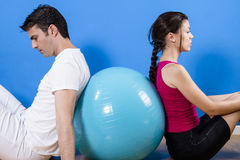 Beautiful athletic couple with fitness ball. Royalty Free Stock Photography