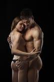 Beautiful athletic couple over black Royalty Free Stock Image