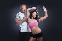 Beautiful athletic couple posing and training. Royalty Free Stock Image
