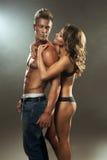 Beautiful athletic couple. Beautiful athletic couple in studio stock image