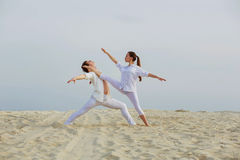 Beautiful athletic couple workout dance  on the beach Stock Images
