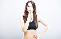 Beautiful athletic fitness trainer woman and whistle stock photography