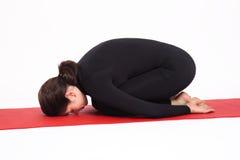 woman doing yoga balasana  childs pose stock photo