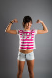 Beautiful athletic girl on a gray background Stock Images